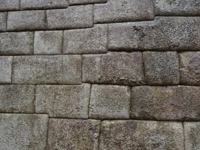 Perfectly fitted stone wall at Machu Picchu, Peru.