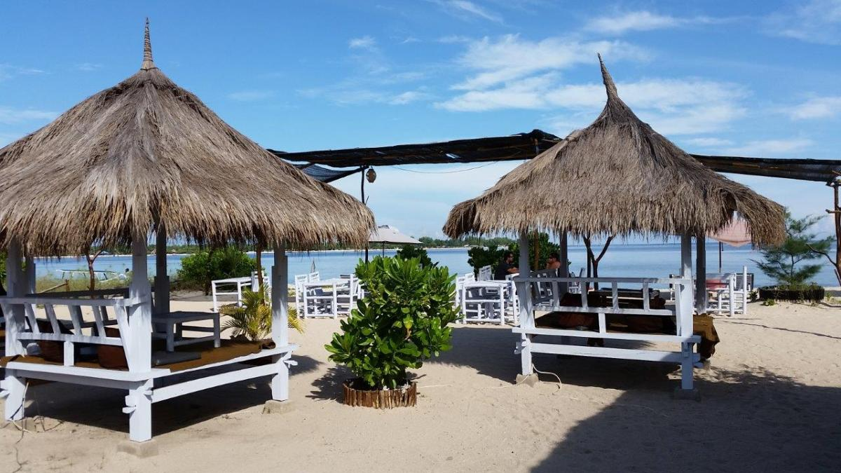 The nice restaurant and beach area at Sunset Beach Bungalows. Gili Meno island, Indonesia