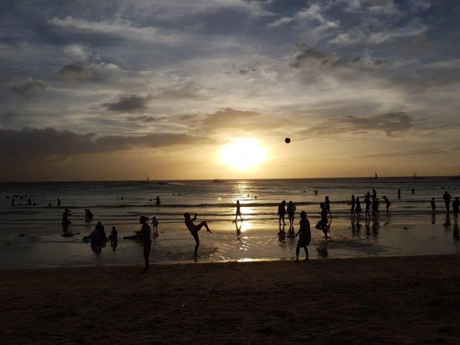 Locals and tourists enjoying the last of the day before the sun sets. Boracay Island, The Philippines.