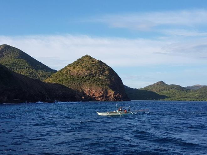 Locals passing by. Three day expedition with El Nido Paradise from El Nido to Coron. Philippines.