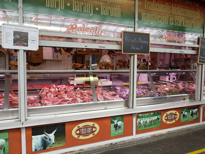 Meat shop at the market in Buda. Taste Hungary food tour. Budapest, Hungary.