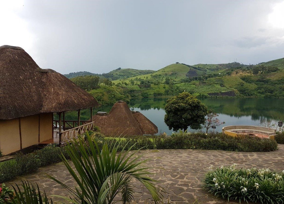 Huts and lake view at Crater Safari Lodge by Kibale Forest National Park, Uganda.