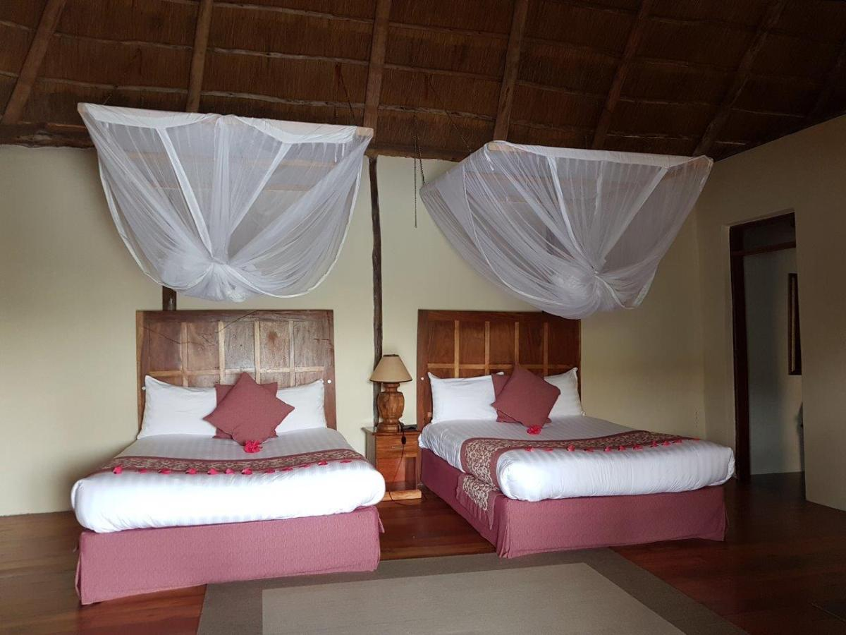Nice and comfortable beds in our room at Crater Safari Lodge by Kibale Forest National Park, Uganda.