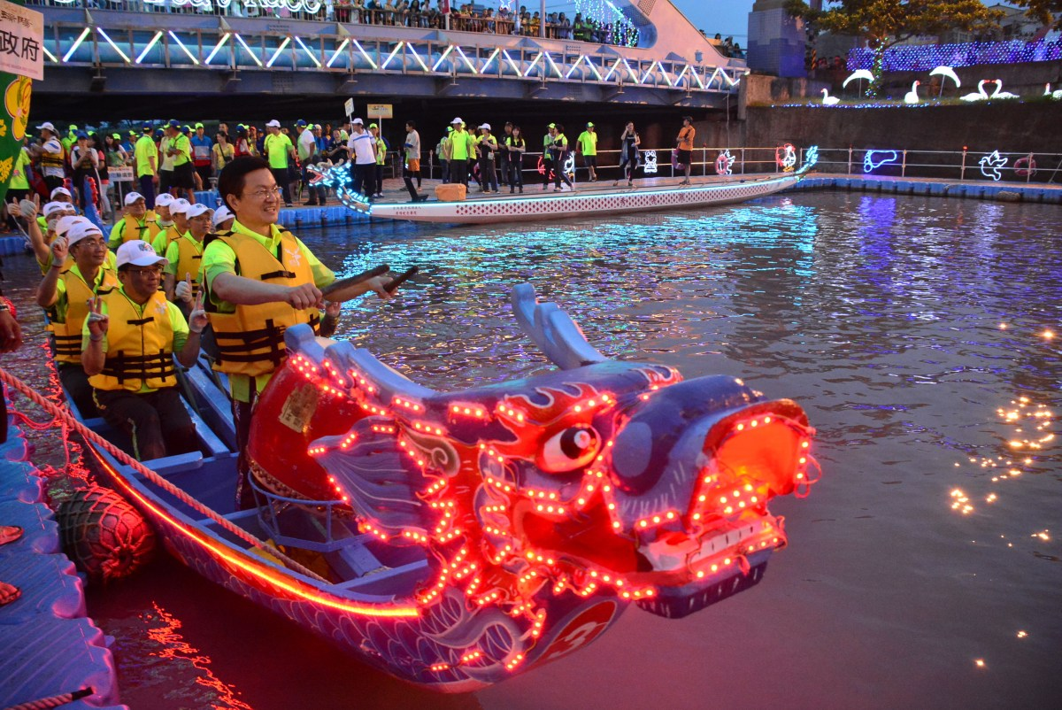A dragon boat race game held at night time as part of the annual Lu-Kang Dragon Boat Festival Celebration Series events.
