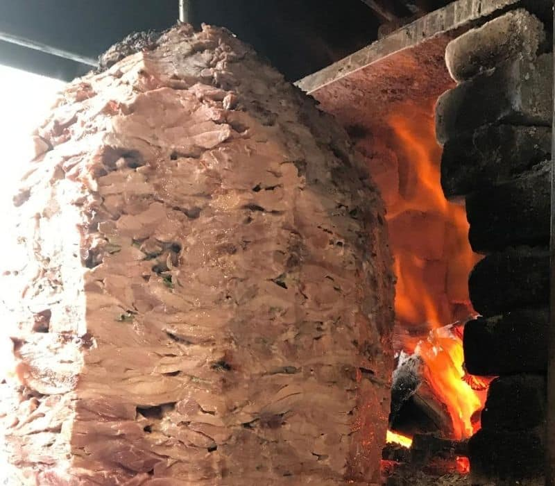 meat cooking on a spit or trompo