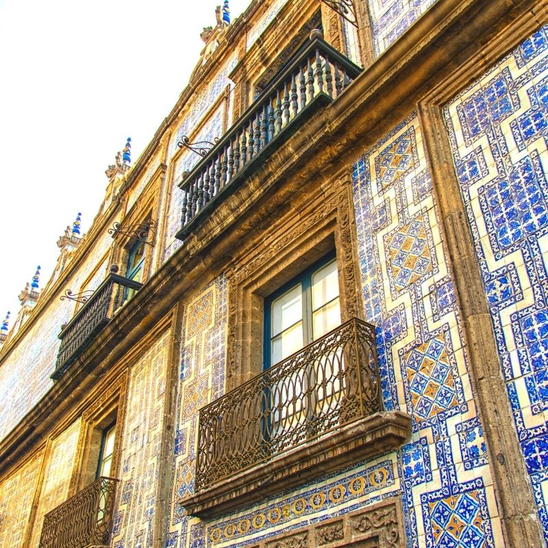 blue tile work on the side of the Casa de los Azulejos (House of Tiles)