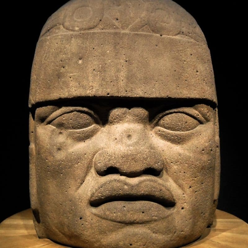 giant Olmec stone head sculpture at Anthropology Museum in Mexico City