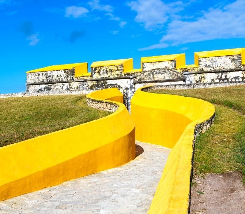 yellow wall surrounding a fort