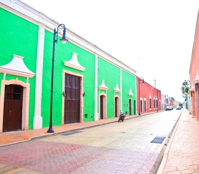 green and pink buildings in a colorful colonial townl