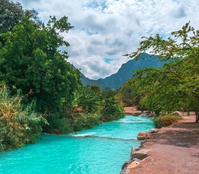 bright blue water in a flowing river - Visit Las Grutas Tolantongo