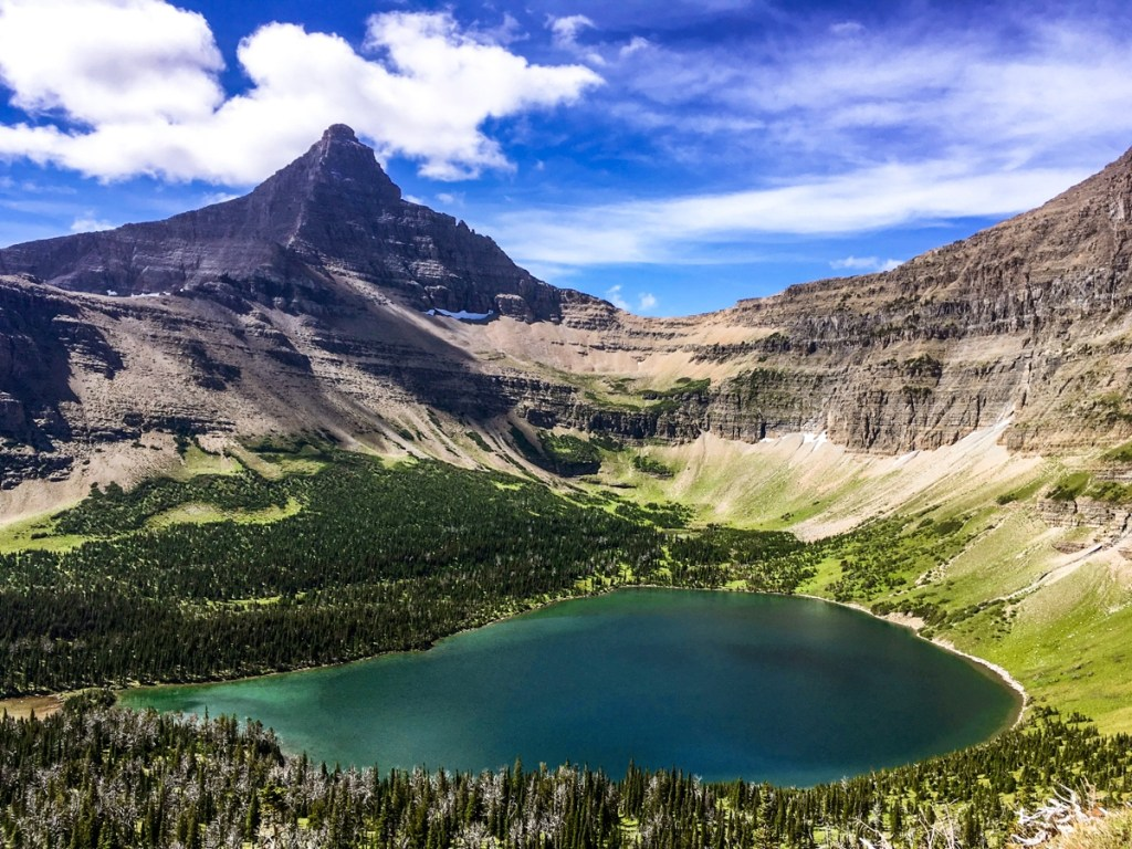 Glacier National Park mountain peak and lake.