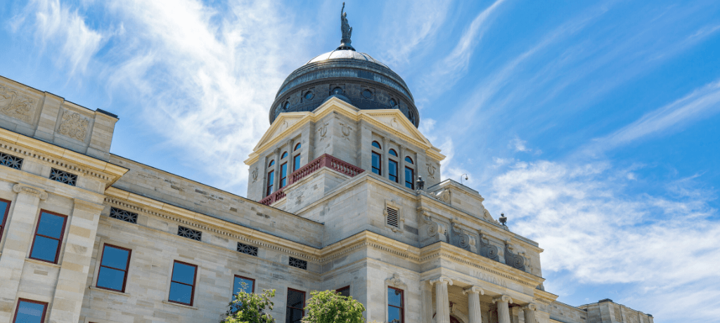 Montana State Capitol Building in Helena, Montana, under a blue sky.