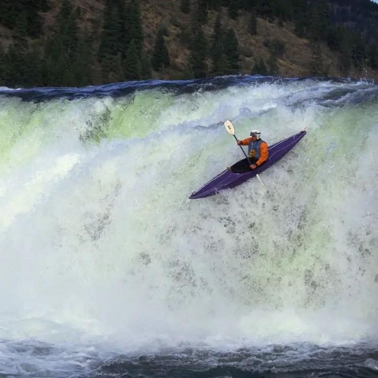 Kayaker navigating Kootenai Falls in Montana.