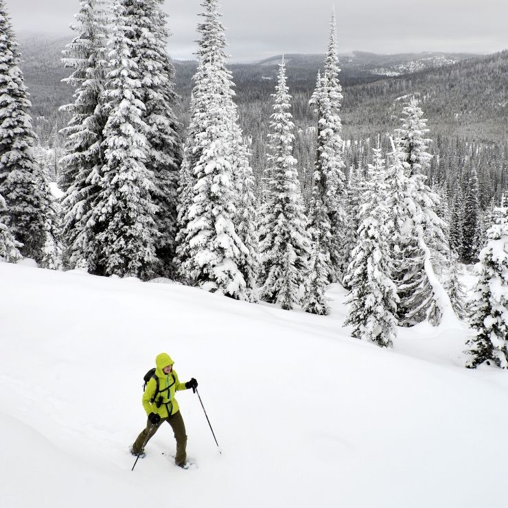 Snowshoer in Montana near Lolo. Snowshoeing is one of the top things to do in Montana in the winter.