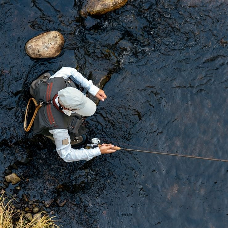 Fly fisherman in river. Fly fishing is a popular thing to do in Miles City, Montana.