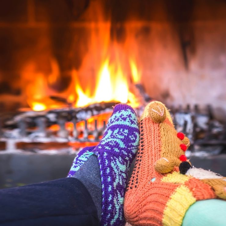 Cozy up as a couple in front of a fireplace at a lodge or in a cabin in Montana.
