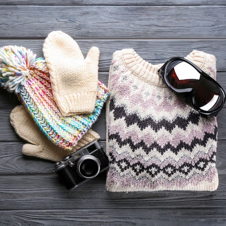 Ski Packing Must-Haves: Sweater, Mittens, Hat, Goggles, Camera