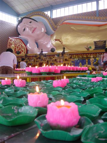Burning my little lotus candle for Buddha