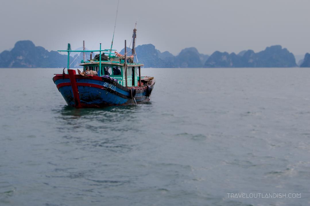Bai Tu Long Bay - A fishing boat headed home