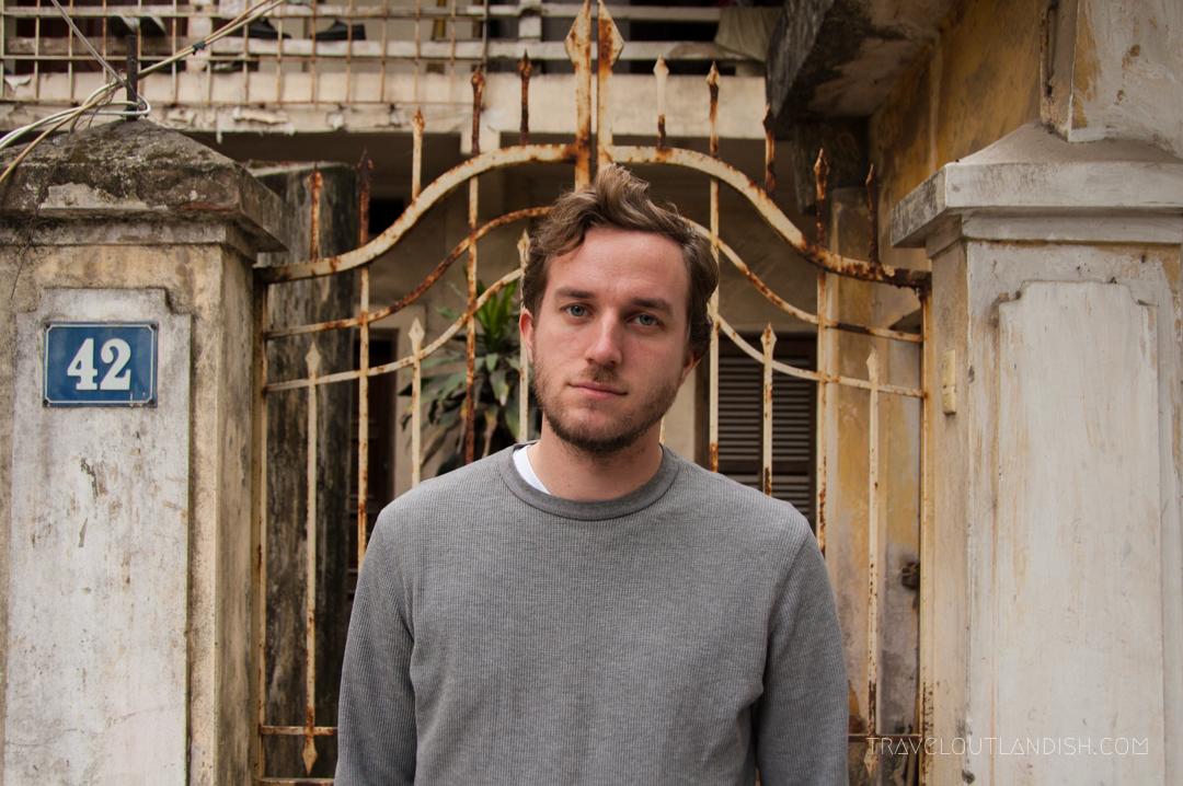 Daniel standing outside a home in Hanoi