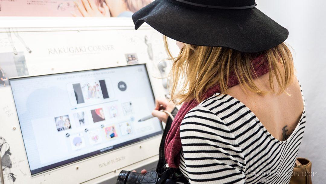 Taylor editing photos in Purikura booth