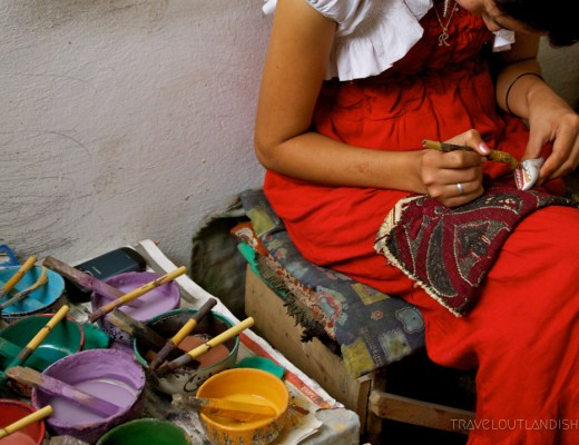 Woman painting ceramics in Fes