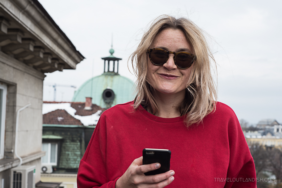 Taylor on a rooftop in Sofia sing the Skyscanner App