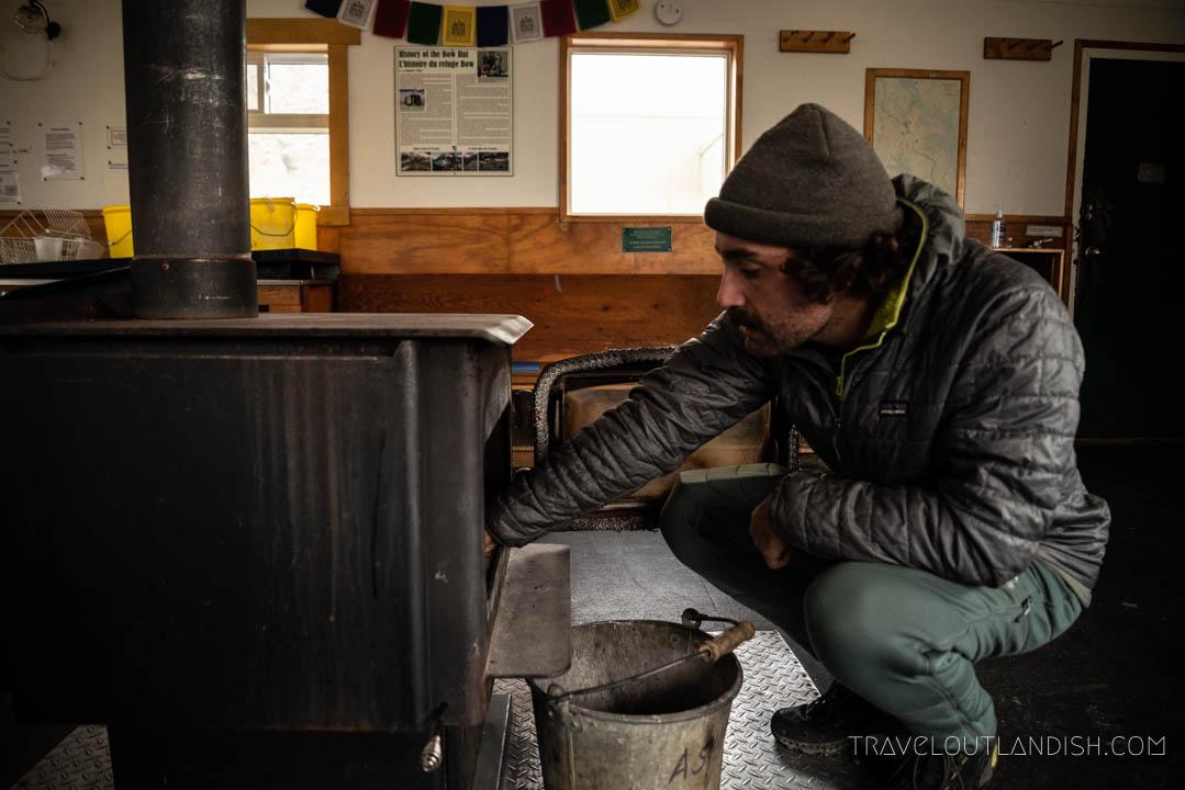 Jake Lighting a Fire in Bow Hut