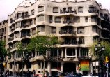 Wave-like front of Casa Mila (La Pedrera); built to hold apartments, the building is now owned by Caixa de Catalunya, a savings bank