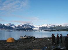 Camp and icebergs on Alsek Lake--tent in foreground is a homemade sauna.