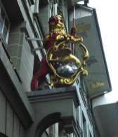 A statue above the door to a hotel in Bern