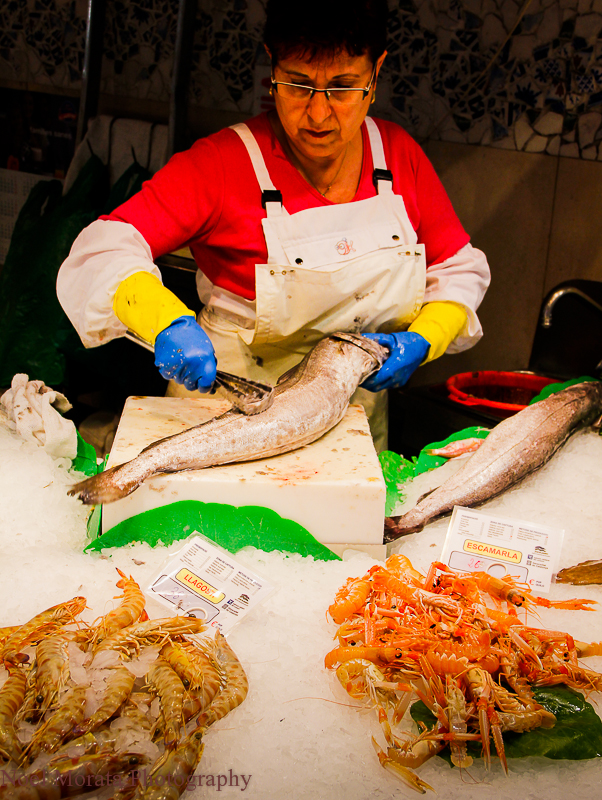 Fish vendor cleaning fish