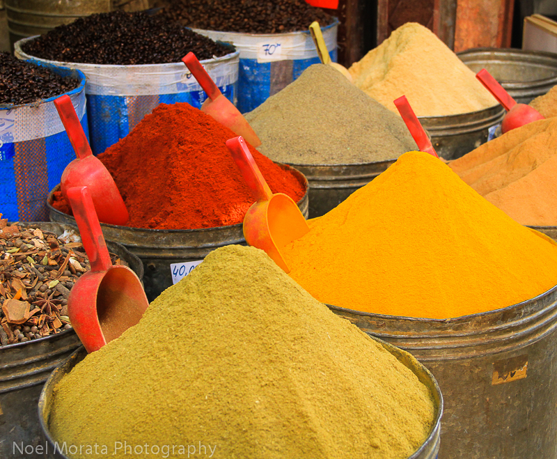 Colored containers of spices for sale