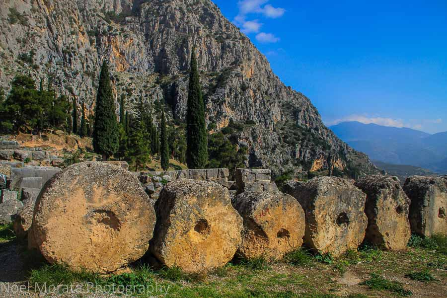 Artifacts and pieces of sculpture line the walkways around the Oracles of Delphi