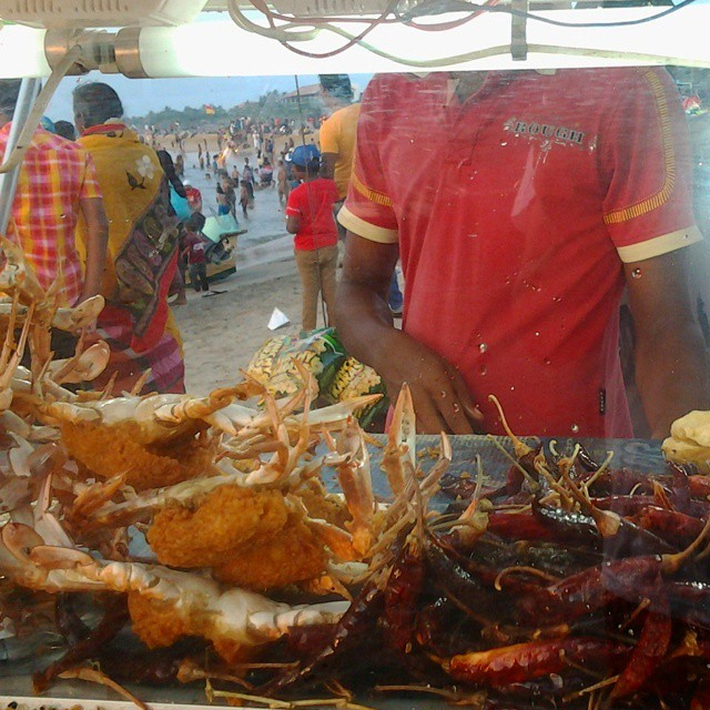 Crabs and fried foods at a beach stand in Negombo, Sri Lanka
