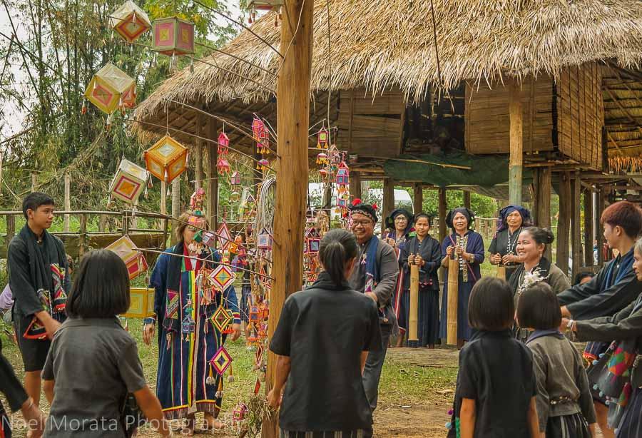 Traditional dance around a harvest pole at Tai Dam Village