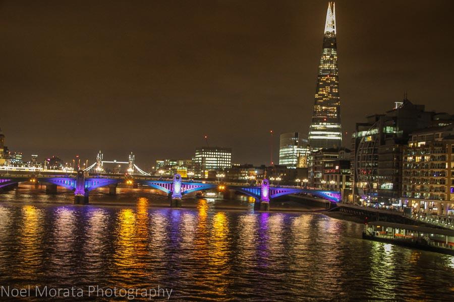 London bridges lit up along the Thames river