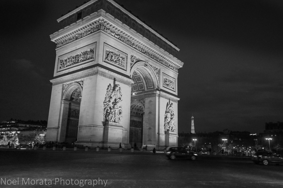 Lit up majestically, the Arc de Triomphe