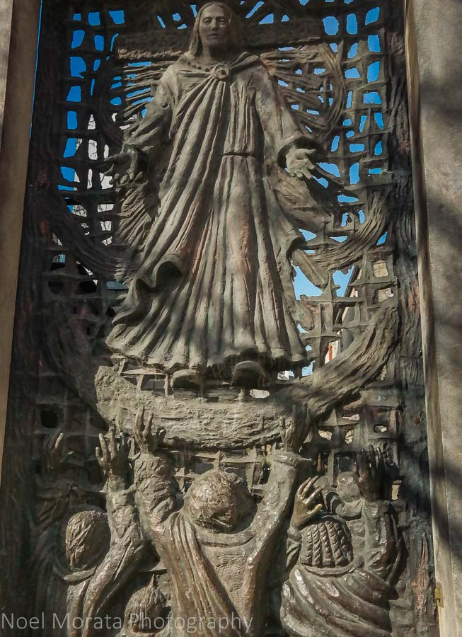 Gorgeous outdoor gate reliefs next to the Abbey at Sacre Coeur