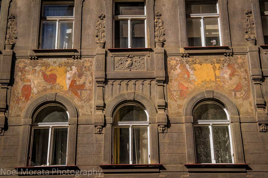 Painted façade detail in Prague's historic central district