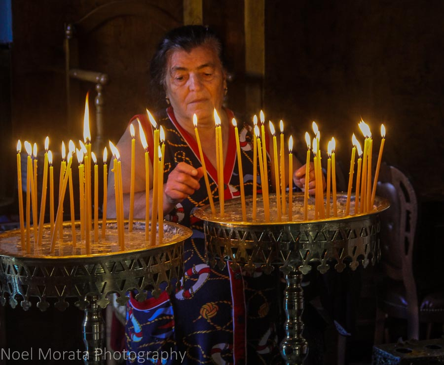 Lighting candles at the Church of the Trimartyri in Chania, Crete