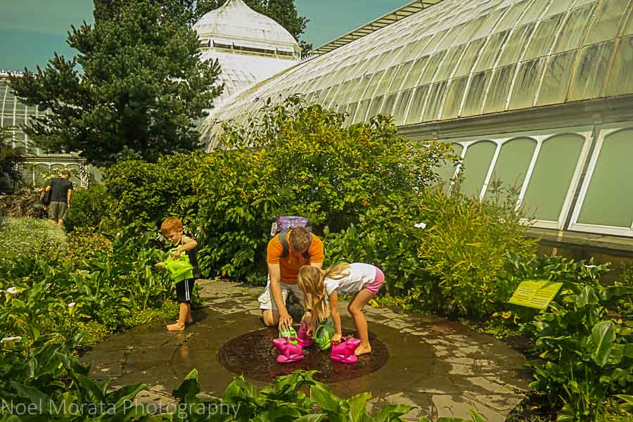 Watering the gardens at Phipps conservatory tour