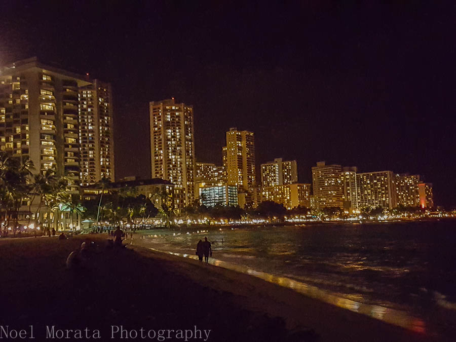 Waikiki beach and city scape at night time