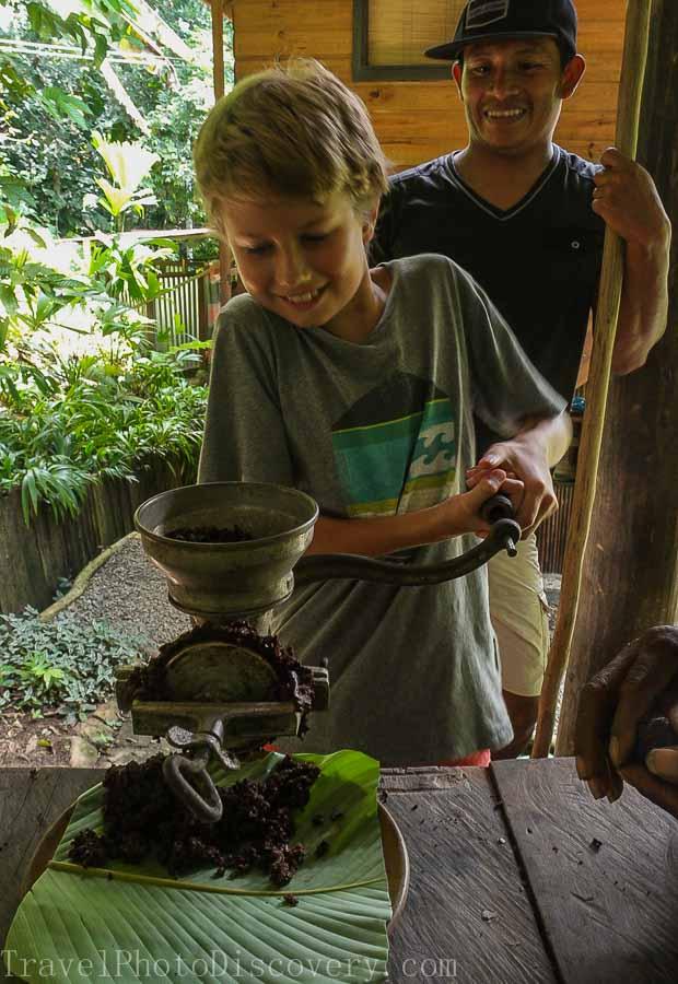 Grinding cacao nibs into cacao paste at La Loma Bastimentos