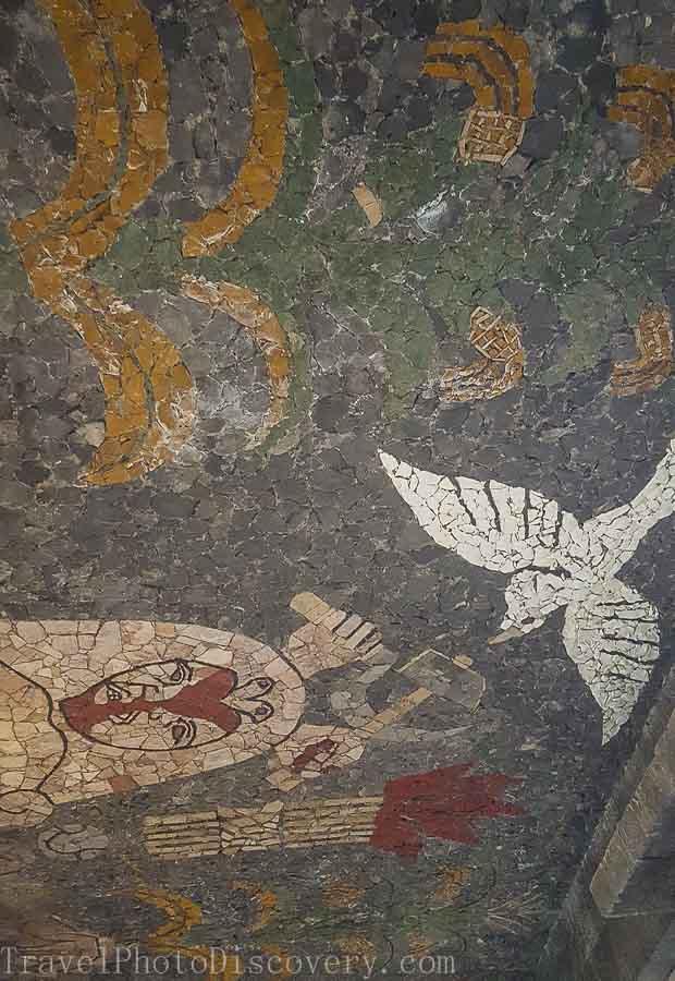 Beautiful tile mosaics on each floors ceilings