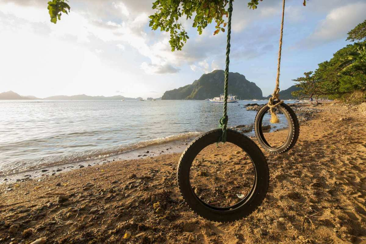 Swings made from old tires in Corong Corong Beach, El Nido