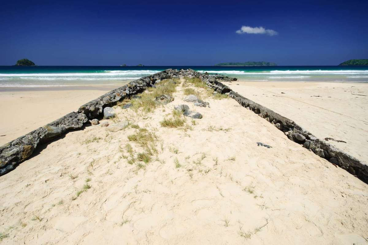 Remnants of the old pier at Nacpan Beach, El Nido