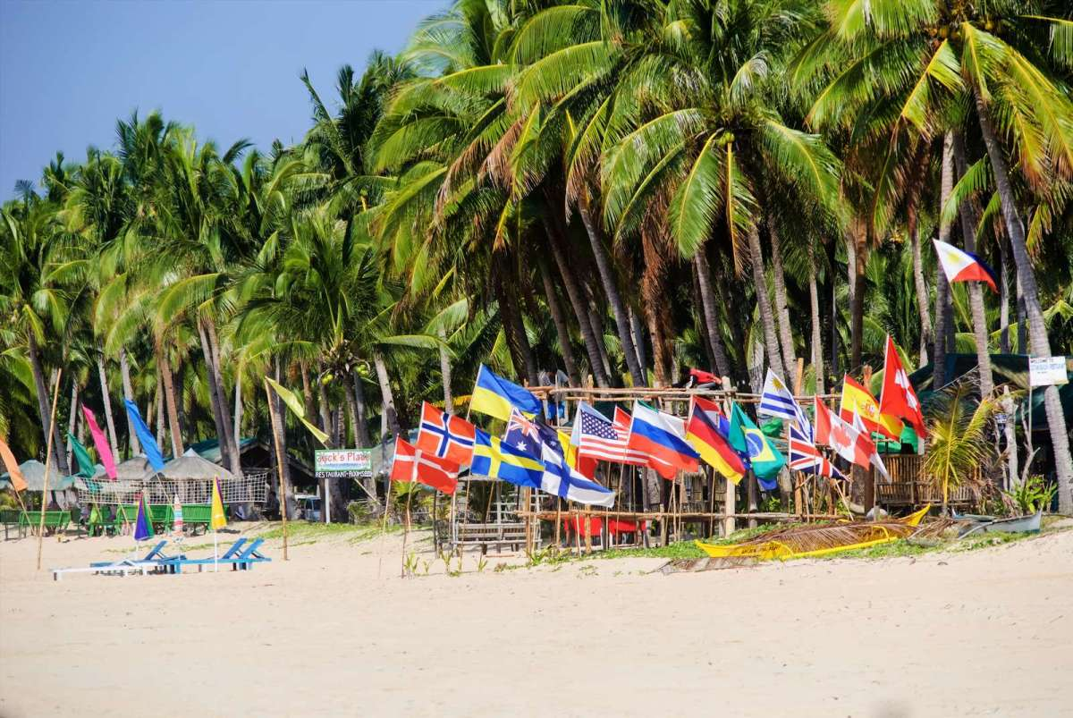 Jack's Place and its collection of flags, Nacpan Beach, El Nido
