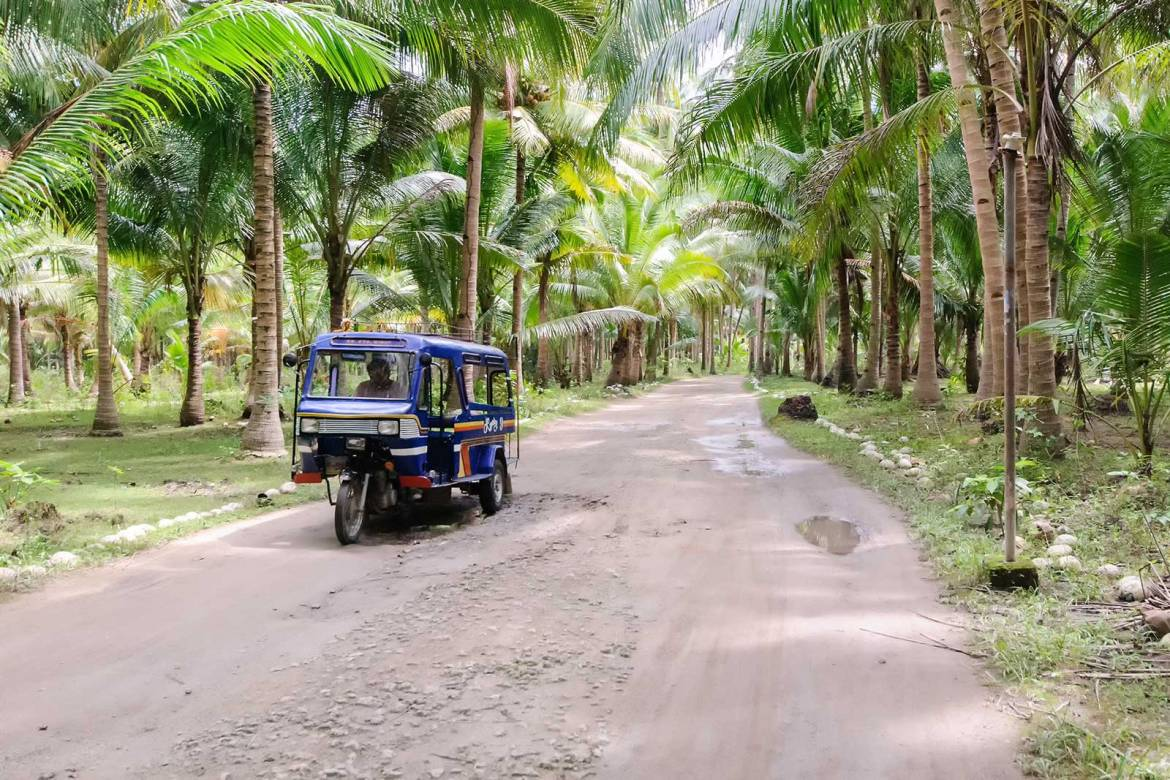 Tricycle plying the back roads of Bantayan Island