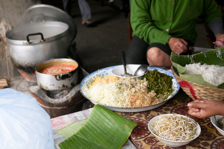 A steaming pot of soup for a traditional breakfast in Luang Prabang, Laos
